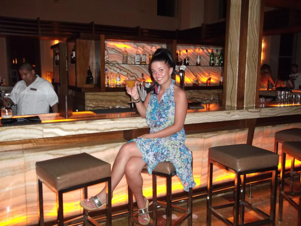 Steph enjoying the bar at Excellence Playa Mujeres