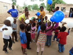 The kids having fun with balloons