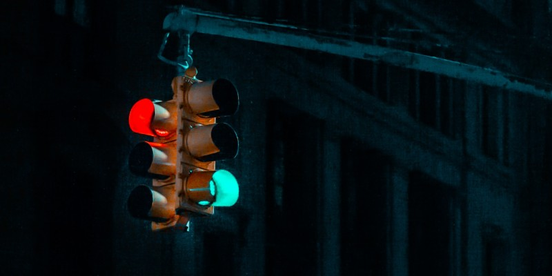 a traffic light shows a red and green light