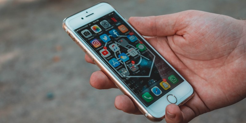a man holding an unlocked smartphone