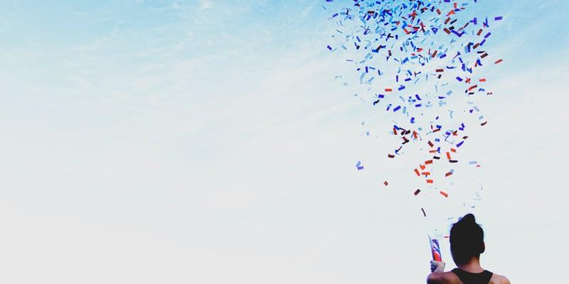 Man celebrating with a confetti canon